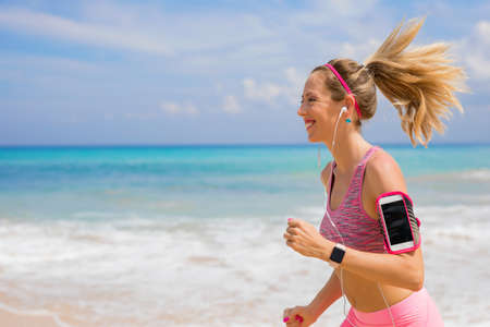 Woman run on the beach Stock Photo