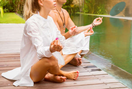 Couple meditate together