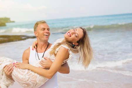 Romantic couple enjoying day at the beach