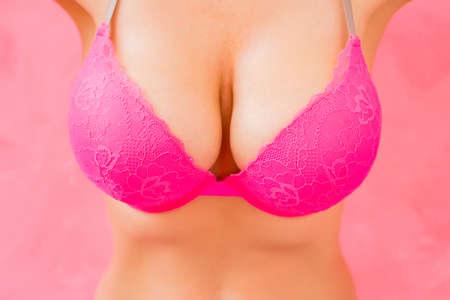 Big breasts after augmentation plastic surgery Archivio Fotografico