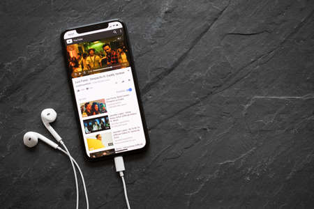 Riga, Latvia - March 25, 2018: iPhone X playing popular song Despacito on YouTube video player.