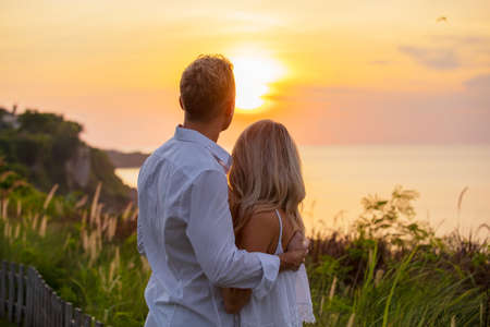 Romantic couple looking at sunset Stock Photo - 99618240