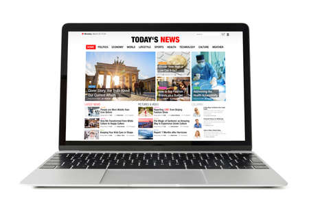 News website on laptop. All contents are made up.