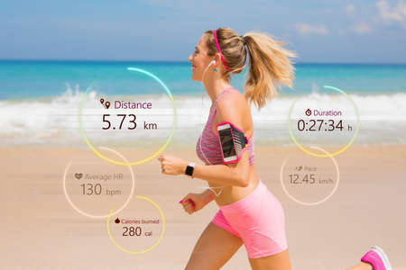 Woman running, wearable tech concept Stockfoto
