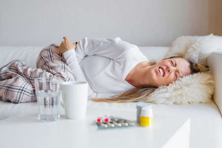 Woman suffering from abdominal pain Stock Photo
