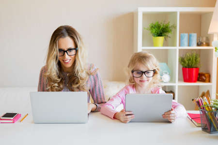 Mom and daughter using modern tech together Stock Photo