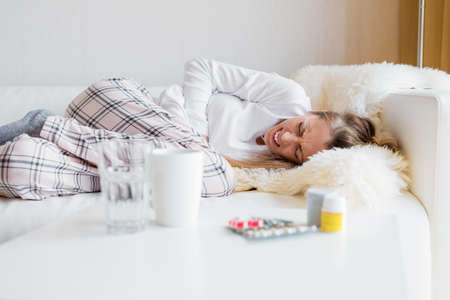 Woman having stomach cramps Stock Photo