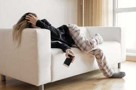 Apathic lazy woman lying in sofa Stock fotó