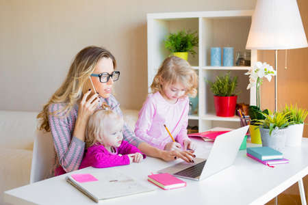 Busy mom multitasking Stock Photo