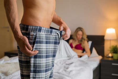 Man having erectile problem in bedroom 스톡 콘텐츠