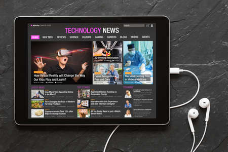 Tech news website on tablet. All contents are made up. Archivio Fotografico - 104172076