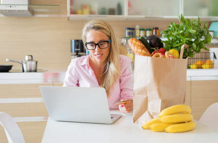 Woman ordering groceries online
