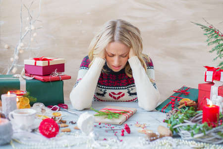 Woman in stress about Christmas holidays Standard-Bild