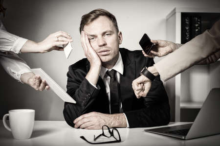 Man overwhelmed with tasks and responsibilities at work Stock Photo - 108462596
