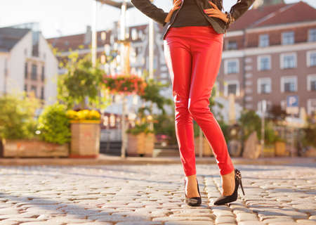 Woman wearing red leather trousers