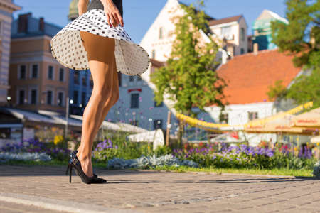 Woman with slim legs walking in city 免版税图像 - 108464418