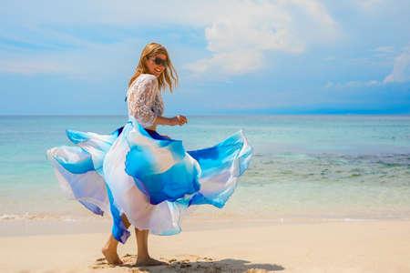 Happy woman enjoying life on tropical beach Stock Photo