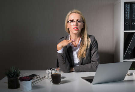 Frustrated woman working late at office