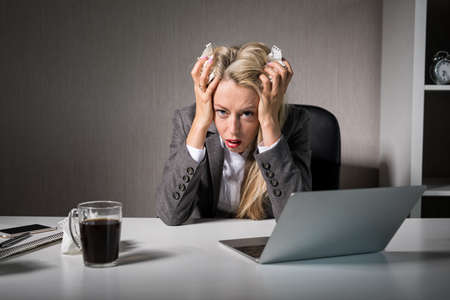 Woman having bad day at office Stok Fotoğraf