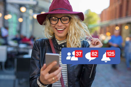 Woman excited about getting attention on social media Stockfoto