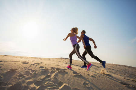Couple during endurance training outdoors