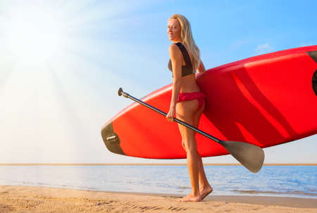 Woman with paddle board