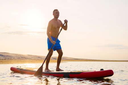 Man enjoying ride on paddle board