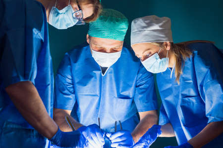Team of doctors working during surgery