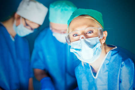 Doctors working in surgery room
