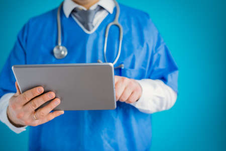 Close-up of doctor with tablet computer Banco de Imagens