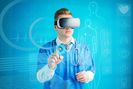 Futuristic concept of doctor using virtual reality glasses with future technology Banco de Imagens