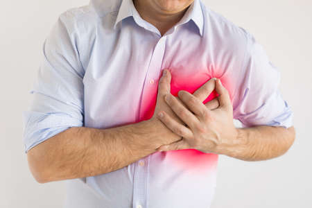 Man suffering from heart pain. Heart attack concept.