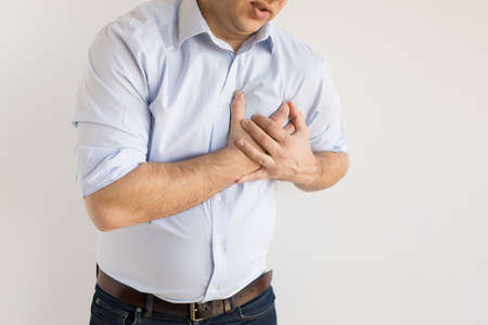 Man holding his chest in pain. Heart attack symptom.