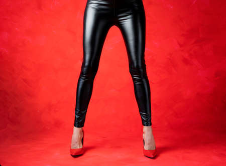 Sexy woman wearing black leather pants and high heels Stock fotó