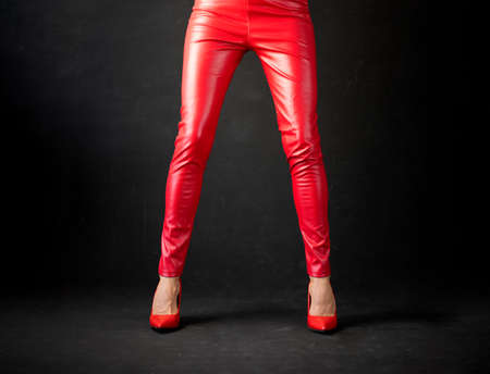 Woman wearing red leather pants and red high heel shoes Stock fotó