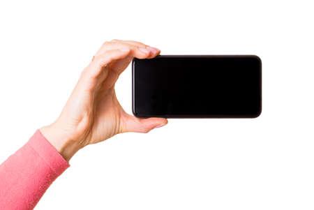 Person holding mobile phone horizontally, photo isolated on white background