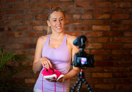 Woman making video blog content
