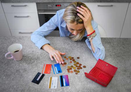 Woman counting last coins left Banco de Imagens