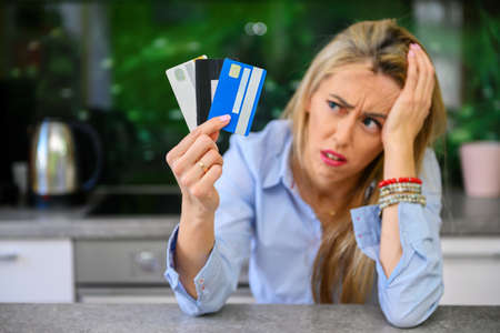 Desperate woman with credit card debt Imagens