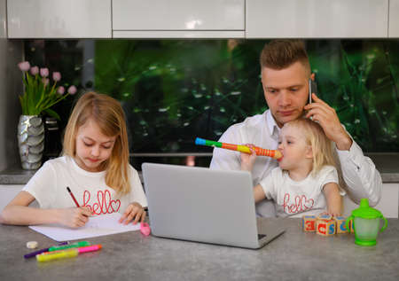 Father of two daughters trying to work from home