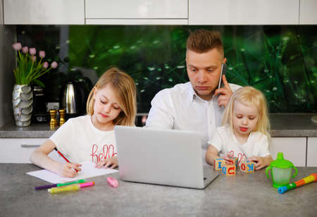 Father working from home with children around