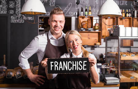 Woman and man starting their franchise business Zdjęcie Seryjne