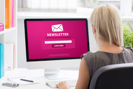 Woman subscribing to newsletter on some website