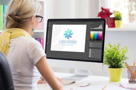 Graphic designer creating company's logo on desktop computer Stock Photo