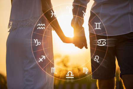 Concept photo of couple with perfect match and love compatibility between zodiac signs Foto de archivo
