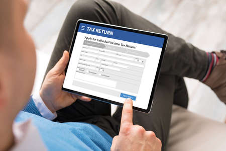Man submits electronic individual income tax return form