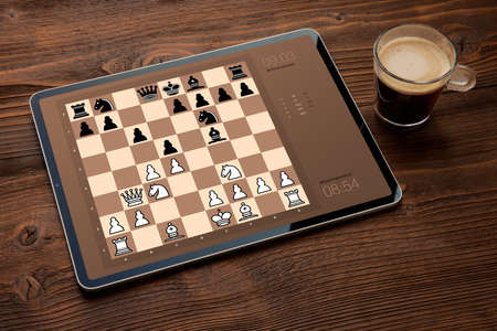 Digital tablet with chess app on screen