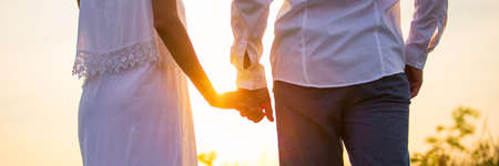Banner with closeup photo of couple holding hands