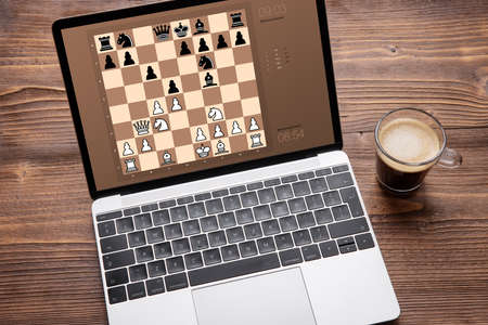 Online chess program on laptop computer
