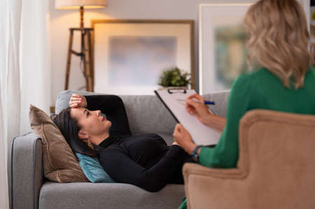 Woman lying in couch during therapy session